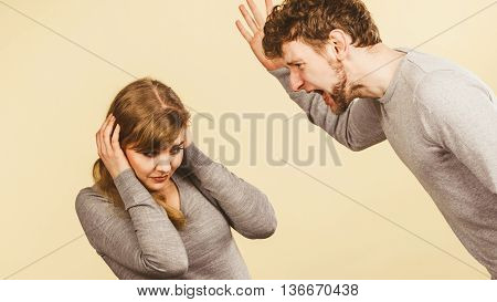 Aggressive Man Yelling On Woman.