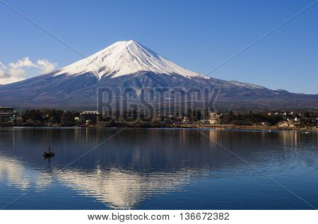 Mt Fuji View From The Lake With A Boat And Reflection