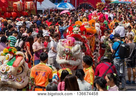 BANGKOK THAILAND - FEBRUARY 08 2016 : A crowd of people roams the street of Yaowarat during the celebration of Chinese New Year and Valentine's Day. Yaowarat is a Chinatown situated in Bangkok.