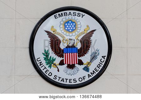 BANGKOKTHAILAND - FEBRUARY 13 2016: The USA embassy sign. The embassy is located on Wireless Road in the heart of Bangkok.