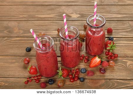 Berry smoothie on a brown background close up
