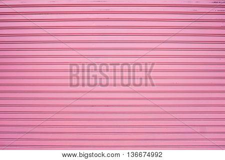 Background of old corrugated pink metal sheet