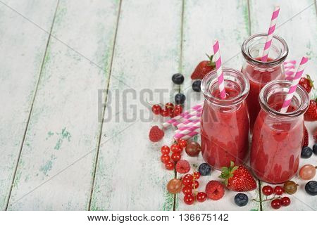 Berry smoothie on a white background close up