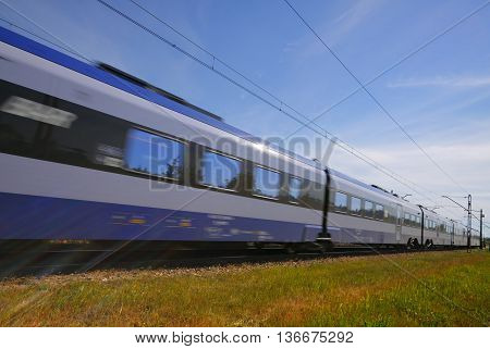 Commuting fast passenger train with motion blur