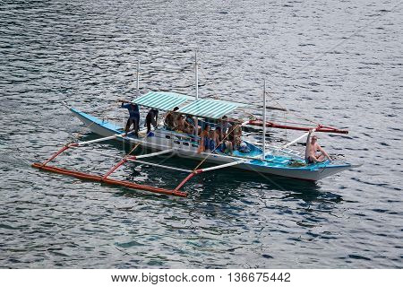EL NIDO PHILIPPINES - FEBRUARY 03 2014: Boat with tourists to travel between the islands. El Nido is one of the top tourist destinations in the world.