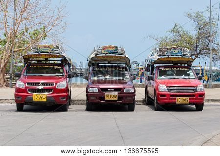 KOH SAMUI THAILAND - APRIL 18 2016 : Songthaew pick-up truck at Nathon pier in Koh Samui. Songthaews are used as public share taxis in Thailand with set routes.