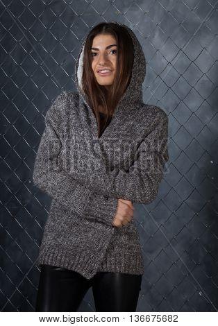 hot brunette woman in black leggings and jacket
