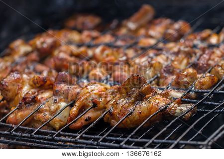 Barbecue Chicken Cooking On The Grill