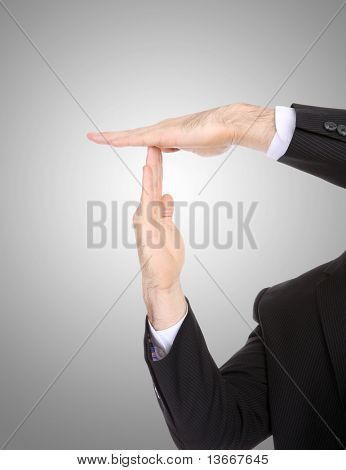 A business man signaling time-out with hands