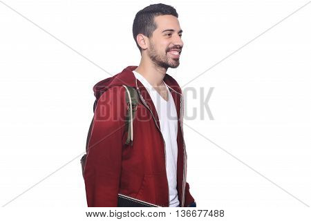 Portrait of young latin man with backpack. Isolated white background.