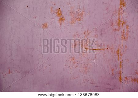 rust has penetrated through the coating layer purple paint background