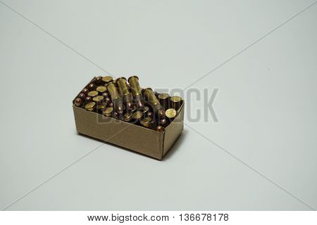 Bullets .22 mm in box on white background