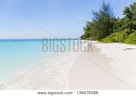 Beautiful crystal clear sea and white sand beach at Tachai island Andaman Thailand. Copy space background