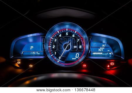Modern car instrument dashboard panel or speedometer in night time
