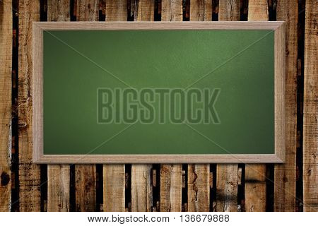 Blank old school blackboard on a grunge wall and can input text or data to wooden frame for concept of education.