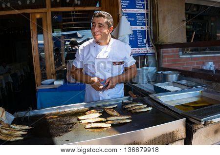 Anadolu Kavagi Turkey - Aug 28 2013: Fish seller street food vendor of grilled bonito fish