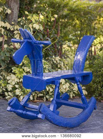 Children toy of blue wooden rocking horse chair