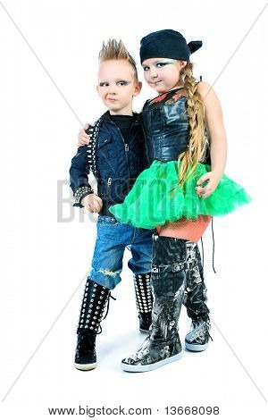 Shot of little boy and girl singing rock music in studio. Isolated over white background.