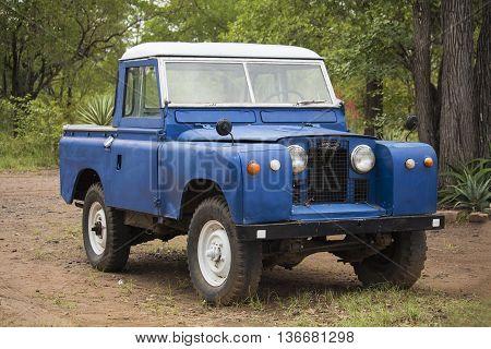 Hwange National Park, Zimbabwe -  April 05, 2015: Land Rover old model 4 W vehicle in Hwange National Park of Zimbabwe. Vintage car style.