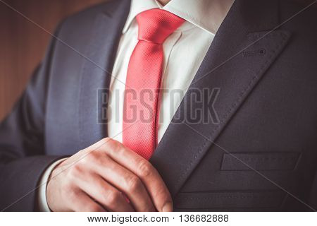 A man in a suit with a red tie