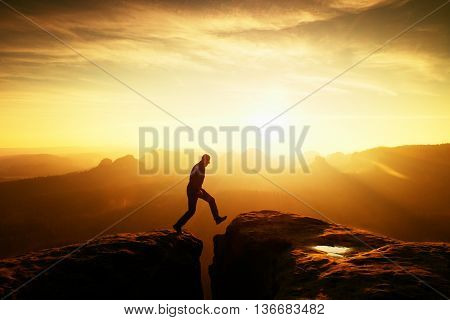 Crazy Hiker Umping Between Rocks. Marvelous Colorful Daybreak