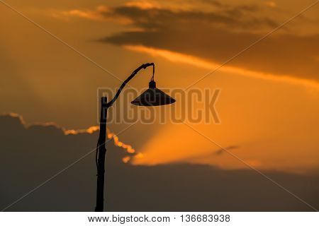 Silhouette of a lamp post at sunset in island Koh Phangan Thailand