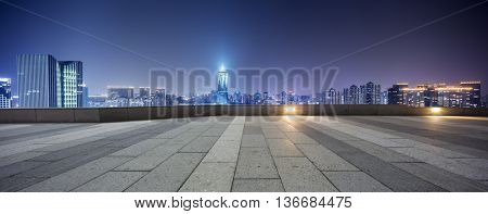 modern office buildings in hangzhou west lake culture square at night on view from empty street