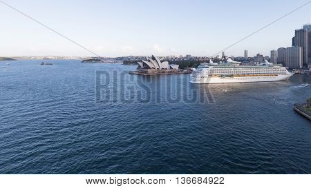 Sydney - February 27 2016: Big cruise ship Voyager of seas comes vport of Sydney and Sydney Opera House view from Harbour Bridge February 27 2015 Sydney Australia