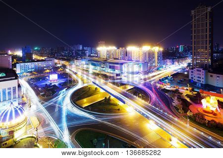 night scene of road junction in downtown of hangzhou at night