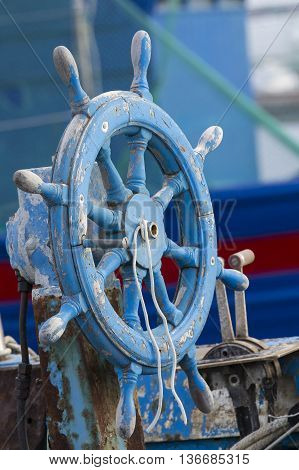 Cagliari: Rudder of an old boat docked in the dock of