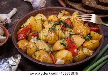 Vegetable stew with tomato and potato in plate close up