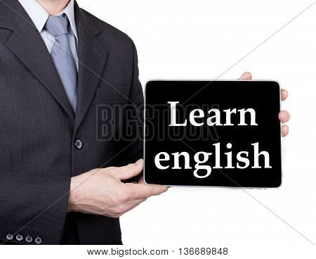 technology, internet and networking in tourism concept - businessman holding a tablet pc with learn english sign. Internet technologies in business and traveling. isolated on white backgroung.