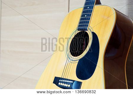 Close-up of Electric Guitar lying on wooden background