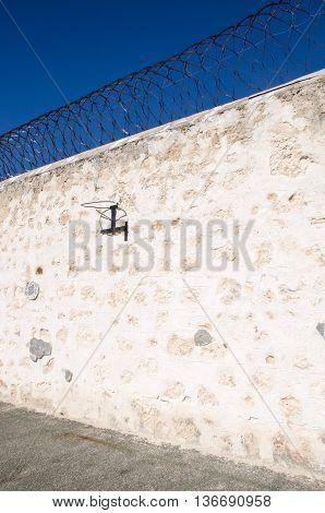 FREMANTLE,WA,AUSTRALIA-JUNE 1,2016:  Basketball hoop on limestone wall of the Fremantle Prison in Fremantle, Western Australia.