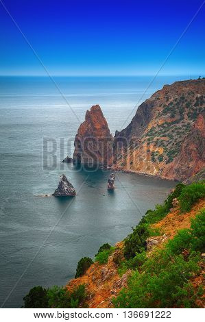 The coast at the cape Fiolent. The top view on the sea and rocks of the cape Fiolent. Crimea