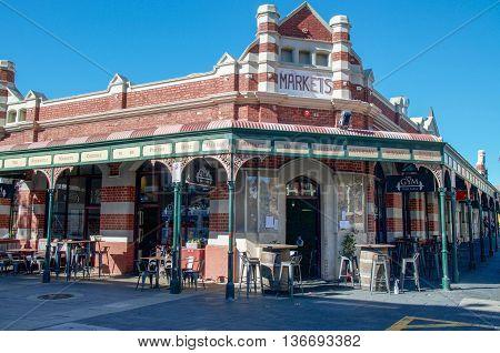 FREMANTLE,WA,AUSTRALIA-JUNE 1,2016: Fremantle Markets brick building and outdoor eating area in Fremantle, Western Australia.