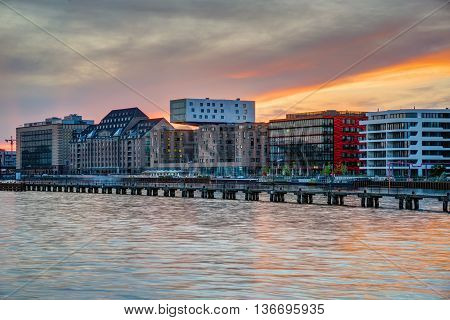 Sunset at the river Spree in Berlin with modern office buildings at the riverbank