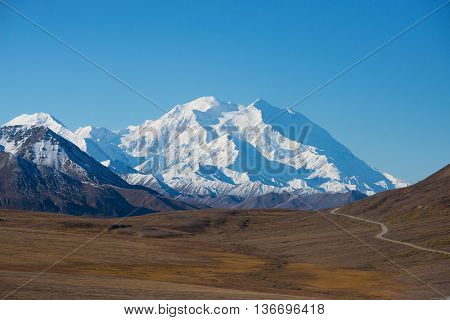 Mount Mckinley's Snowy Peak With The Park Road And Tundra In The Foreground, Denali National Park, A