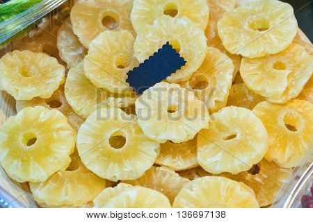 Dried pineapple (ananas) slices in the shop.