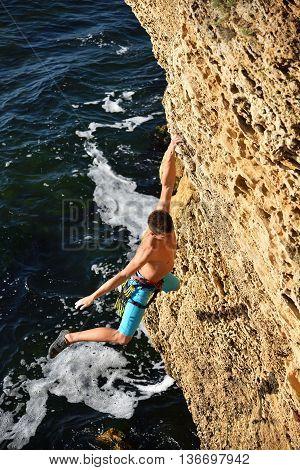 Man Caught On Rock