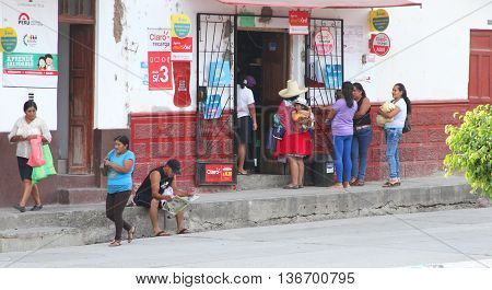Magdalena Cajamarca Peru - June 28 2016: Group of women wait in line to buy goods from small store in Peru in Magdalena Cajamarca Peru on June 28 2016.