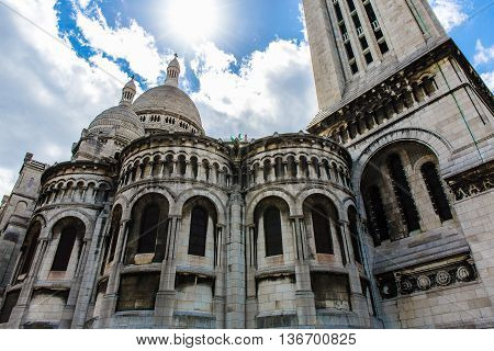Sacre Coeur Cathedral in Paris on the blue sky background