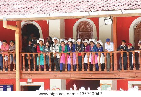 Chamani Peru - June 29 2016: Group of Peruvians watch soccer game from balcony of high school in Chamani Peru on June 29 2016