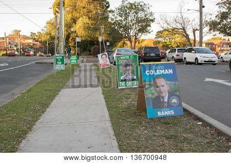 2016 JUL 2: Hurstville NSW Banks and Barton voting district polling areas - pavement lined with various voting posters in anticipation for the arrival of Australians voting in the 2016 federal elections.