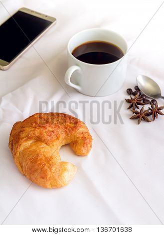 Breakfast With Croissants, And Black Coffee Composition.
