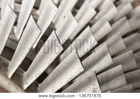 Industrial metal turbine blades in an old factory