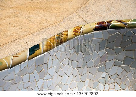 BARCELONA SPAIN - JUNE 10 2014: Detail of a ceramic bench in the Park Guell designed by the famous architect Antoni Gaudi (1852-1926). UNESCO World Heritage Site