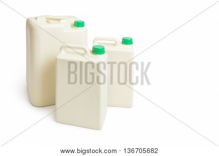 Plastic chemical gallon containers with green cap in two sizes isolated on white background with some cast shadow room for copyspace text