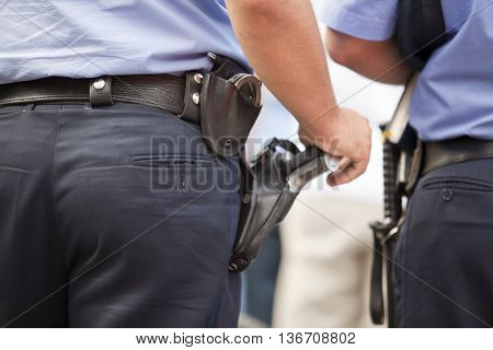 Police officer on duty, taking care of citizens' security. Law enforcement.