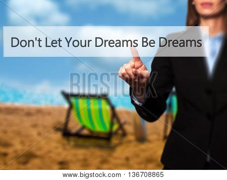 Don't Let Your Dreams Be Dreams - Isolated Female Hand Touching Or Pointing To Button